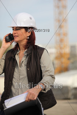Female Architect With Radio Stock Photo