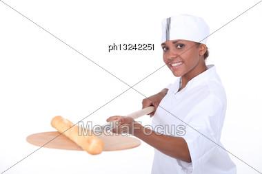 Female Baker Baking A Baguette Stock Photo
