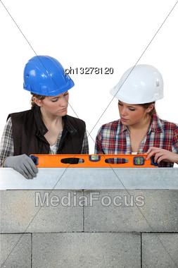 Female Builder With Spirit-level Stock Photo