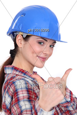 Female Construction Worker With Both Thumbs Up. Stock Photo