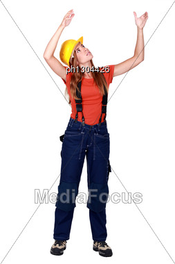 Female Construction Worker Repositioning Something. Stock Photo