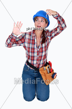 Female Construction Worker Trapped In An Invisible Box. Stock Photo