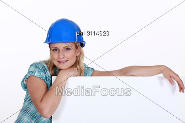 Female Construction Worker With A Billboard Stock Photo