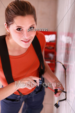 Female Electrician At Work Stock Photo