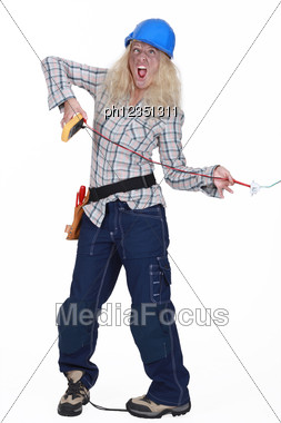 Female Electrician Getting A Shock Stock Photo