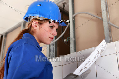 Female Electrician Stock Photo