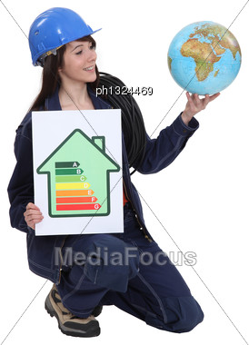 Female Electrician Promoting Energy Savings Stock Photo