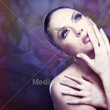 Female Fashion Portrait Against Abstract Floral Backgrounds Stock Photo