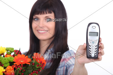 Female Florist Holding Mobile Telephone Stock Photo