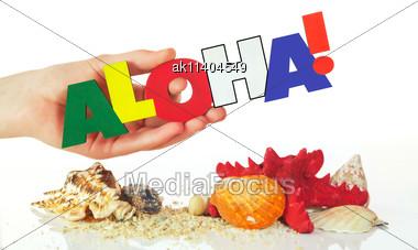 Female Hand Holding Colorful Word Aloha Against White Background Stock Photo