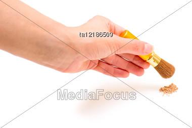Female Hand With Make-up Brush Stock Photo