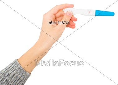 Female Hand Showing Positive Pregnancy Test, Expecting A Baby Stock Photo