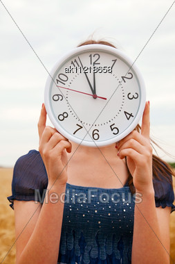 Female Holds Watches Staying Ourdoors Stock Photo