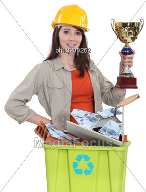 Female Laborer Holding Gold Cup Stock Photo