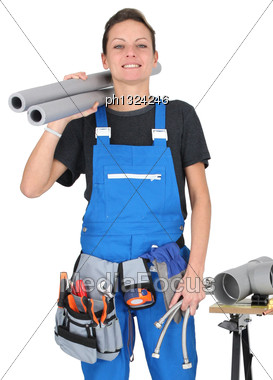 Female Labourer Stood By Tools And Equipment Stock Photo