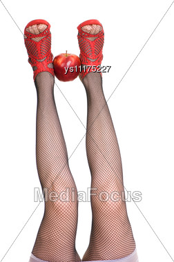Female Legs In Red Shoes Keep Apple Stock Photo