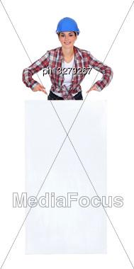 Female Mason Pointing At White Poster Stock Photo