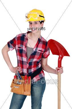 Female Mason With Shovel Stock Photo