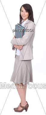 Female Office Worker Carrying Folders Stock Photo