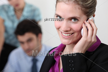 Female Office Worker On The Telephone Stock Photo