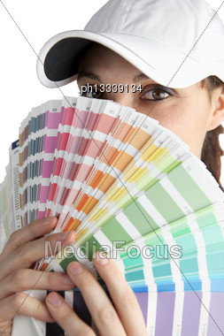 Female Painter Hiding Her Face Up To Eyes With Color Chart Stock Photo