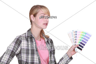 Female Painter Holding A Color Chart Stock Photo