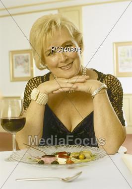 Female Senior Dining with Style Stock Photo