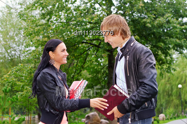 Female Student Talking With Friend Outdoors Stock Photo