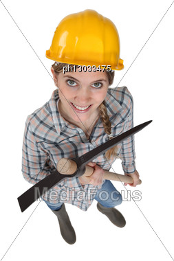 Female Worker Holding An Pickaxe Stock Photo