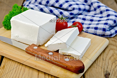 Feta Cheese, Knife, Parsley, Tomatoes, Napkin On A Wooden Board Stock Photo