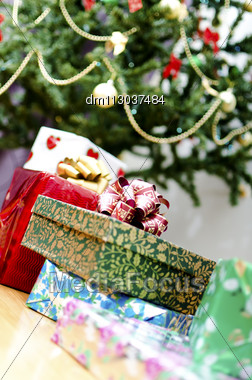 Few Gifts At Christmas Tree Stock Photo