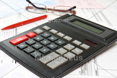Financial Analysis Concept With Calculator,pen And Glasses Stock Photo