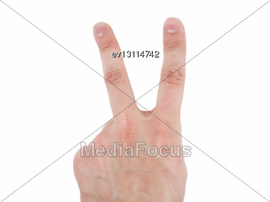 Fingers Of A Hand In The Form Of The Letter V - Victory. Isolated Stock Photo