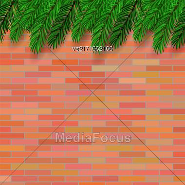 Fir Green Branch On Orange Brick Background Stock Photo
