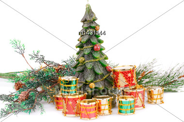 Fir Tree Candle And Toy Drums On White Background Stock Photo
