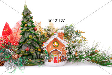 Fir Tree Candle, Toy House And Holly Berry Flowers On White Background Stock Photo