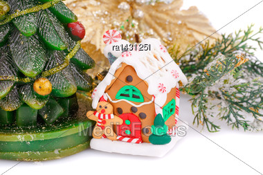 Fir Tree Candle, Toy House And Holly Berry Flower On White Background Stock Photo