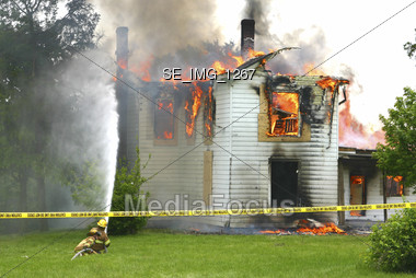 Firemen Putting Fire Out Stock Photo