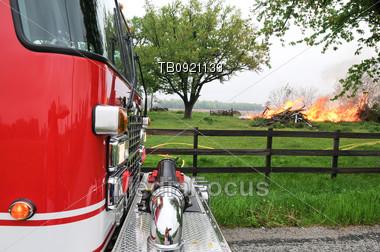 Firetruck waiting on of blazing fire Stock Photo