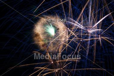 Fireworks On The Night Sky. Holidays Backgrounds Stock Photo