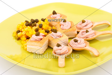 Fish Cream In Pastries, Sweet Corn And Capers On Green Plate Stock Photo