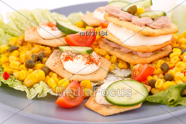 Fish Cream In Pastries, Sweet Corn, Cherry Tomato And Lettuce On Gray Plate Stock Photo