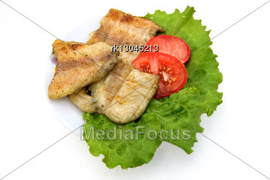Fish Grilled, Two Slices Of Red Tomatoes, Lettuce On A Plate Isolated Stock Photo