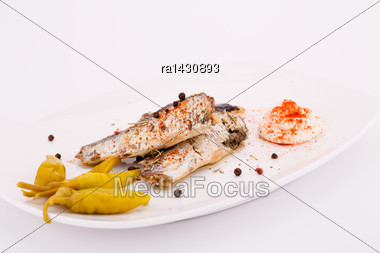 Fish, Peppers And Cream On White Plate Stock Photo