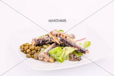 Fish, Peppers, Lettuce And Capers On White Plate Stock Photo