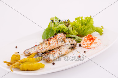 Fish, Peppers, Lettuce And Cream On White Plate Stock Photo