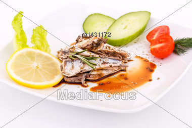 Fish, Vegetables And Lemon On White Plate Stock Photo