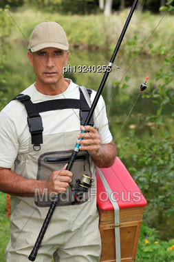 Fisherman In Waders Stock Photo