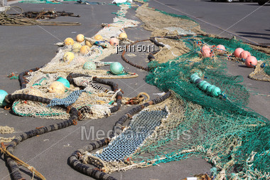 Fishing Nets Lying On The Ground For Drying Stock Photo