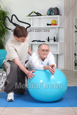 Fitness Coach Giving A Personal Training To A Senior Lady Stock Photo